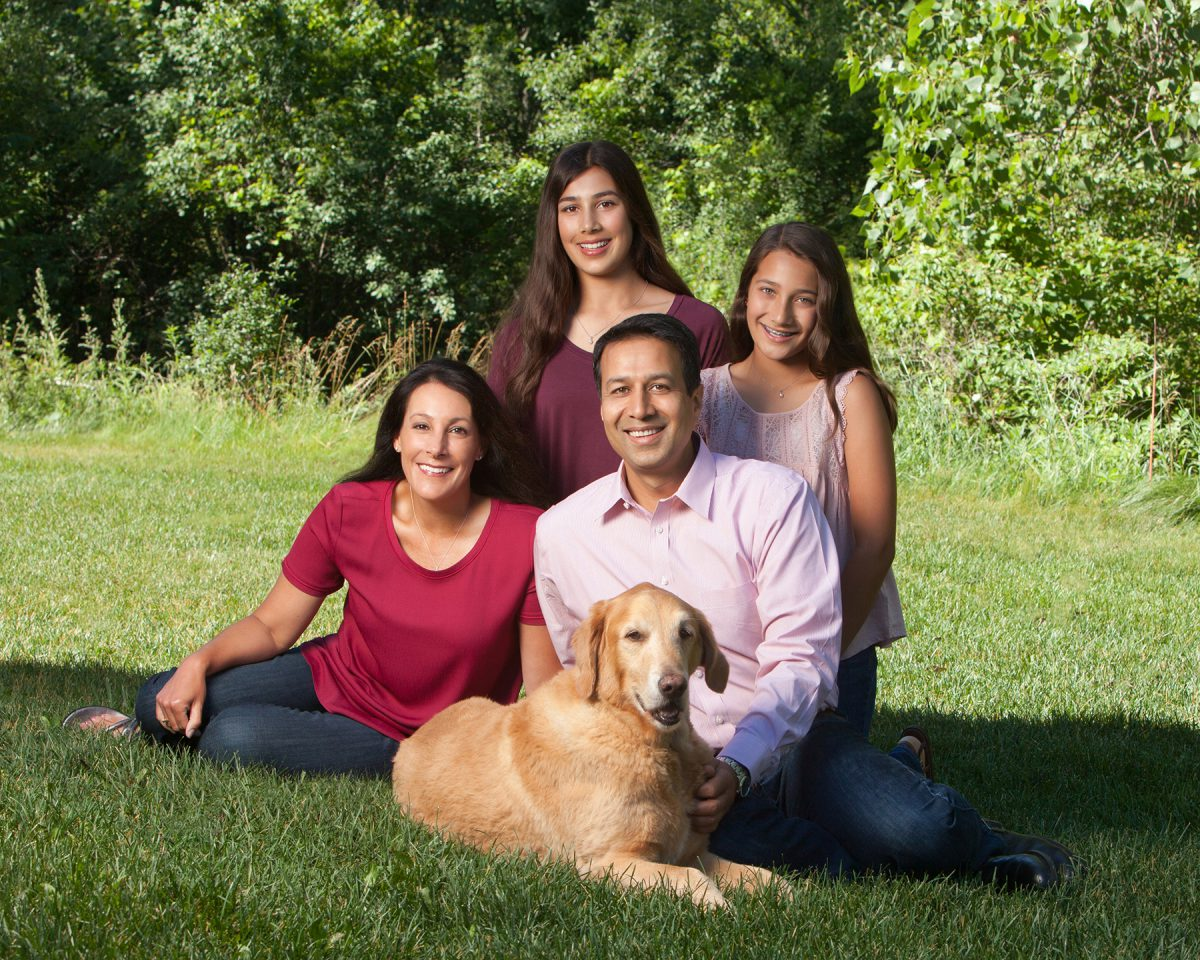 Alam with his wife, Tracy, and daughters Mayah (left) and Aliya, with their dog, Brutus.