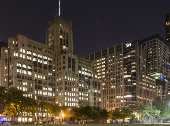 Northwestern campus exterior at night with the Ward building and Prentice Women's Hospital.