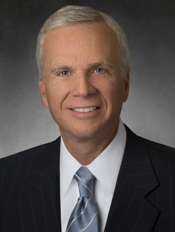Photo of Dean Harrison: Man in suit and tie