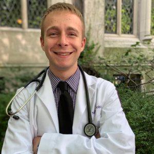 Man wearing white coat and stethoscope